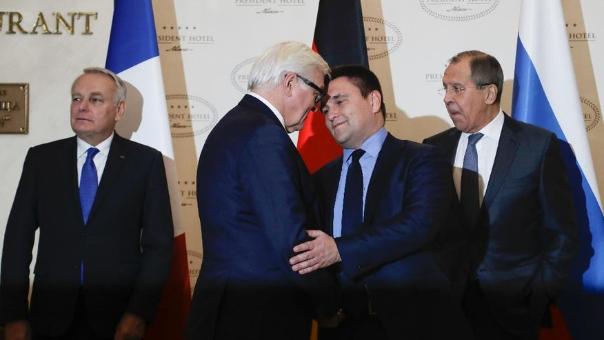 German Foreign Minister Frank-Walter Steinmeier, second left, and Ukrainian Foreign Minister Pavlo Klimkin shake hands as French Foreign Minister Jean-Marc Ayrault, left, and Russian Foreign Minister Sergey Lavrov prepare for posing before talks in Minsk Belarus, Tuesday, Nov. 29, 2016. Foreign Ministers of France, Russia, Ukraine and Germany attend Normandy Format talks in Minsk on the situation in the east of Ukraine. (AP Photo/Sergei Grits)