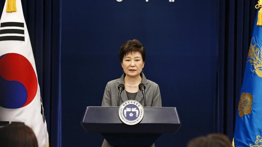 South Korean President Park Geun-hye makes a live televised address in Seoul, South Korea, Tuesday, Nov. 29, 2016. The embattled president said Tuesday that she will resign her office once parliament develops a plan for a safe transfer of power. (Pool Photo via AP)