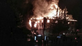 Flames rise from a fire in a school dormitory, in Aladag, Adana in southern Turkey, Tuesday, Nov. 29, 2916. A fire at a middle school dormitory for girls in southern Turkey has left over ten people dead and over a dozen injured, a Turkish governor and state-run media said. (DHA via AP)