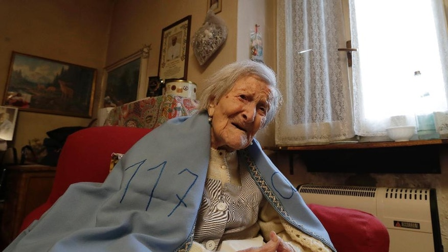 Emma Morano wears a sheet reading 117,  in the day of her birthday in her home in Verbania, Italy, Tuesday, Nov. 29, 2016.  At 117 years of age, Emma is now the oldest person in the world and is believed to be the last surviving person in the world who was born in the 1800s, coming into the world on Nov. 29, 1899. (AP Photo/Antonio Calanni)
