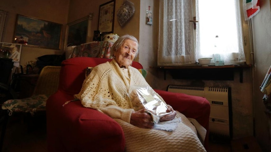 Emma Morano, 117 years hold, sits in her home in the day of her birthday in Verbania, Italy, Tuesday, Nov. 29, 2016.  At 117 years of age, Emma is now the oldest person in the world and is believed to be the last surviving person in the world who was born in the 1800s, coming into the world on Nov. 29, 1899. (AP Photo/Antonio Calanni)