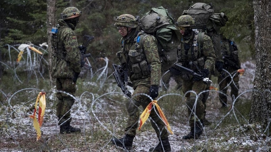 Lithuanian soldiers, takes part in a NATO military exercise, 'Iron Sword,' at the Rukla military base some 130 km (80 miles) west of the capital Vilnius, Lithuania, Monday, Nov. 28, 2016. Lithuanian foreign and defense ministers said they believed that some of Donald Trump's language during the campaign shouldn't be taken too seriously and that they are confident that he will continue a decades-long American tradition of standing by allies in Europe and the world. (AP Photo/Mindaugas Kulbis)