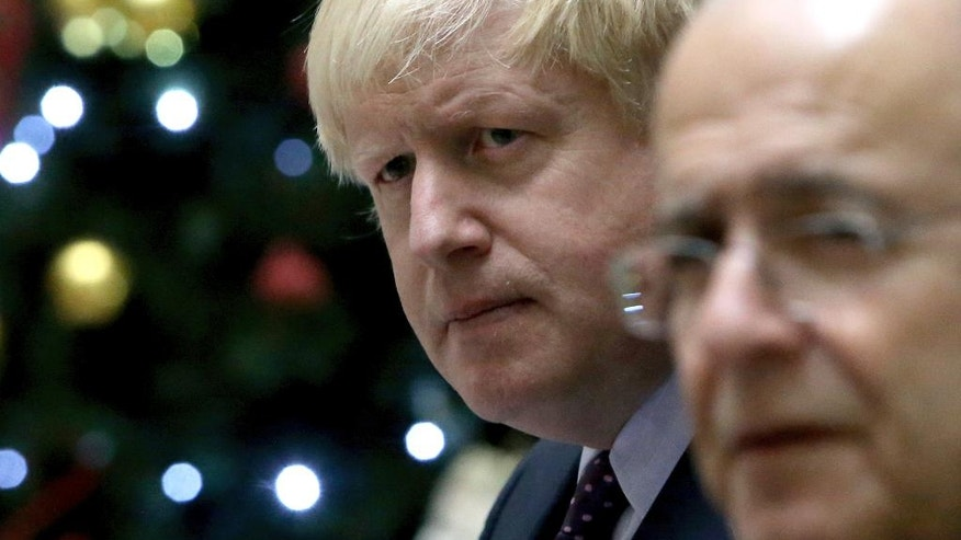 """Britain's foreign secretary Boris Johnson, left, and his Cyprus' counterpart Ioannis Kasoulides attend a press conference after their meeting at the foreign house in capital Nicosia in the eastern Mediterranean island of Cyprus, on Wednesday, Nov. 30, 2016. Britain's foreign secretary says the U.K.'s support for Cyprus amid talks aimed at reunifying the ethnically split island remains """"rock solid."""" Johnson is in Cyprus for three-days official visit. (AP Photo/Petros Karadjias)"""