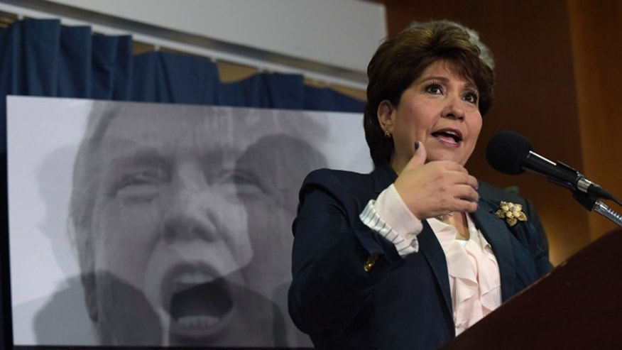 Janet Murguia, the President and CEO of the National Council of La Raza, speaks during a news conference at the National Press Club in Washington, Tuesday, Nov. 29, 2016. Murguia called on President-elect Donald Trump to publicly denounce racism and bigotry. (AP Photo/Susan Walsh)