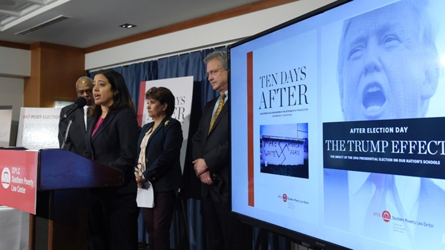 Brenda Abdelall, with Muslim Advocates, second from left, speaks during a news conference at the National Press Club in Washington, Tuesday, Nov. 29, 2016. Abdelall, standing with from left, Wade Henderson, President and CEO of The Leadership Conference on Civil and Human Rights, Janet Murguia, the President and CEO of the National Council of La Raza, and Richard Cohen, president of the Southern Poverty Law Center, called on President-elect Donald Trump to publicly denounce racism and bigotry. (AP Photo/Susan Walsh)
