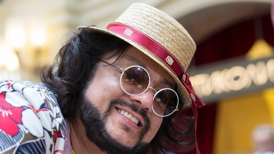 FILE - In this Tuesday, July 5, 2016, file photo, Russian pop singer Philipp Kirkorov smiles at the GUM Department store in Red Square, Moscow, Russia. French composer Didier Marouani and his Russian lawyer Igor Trunov have been detained Tuesday, Nov. 29, 2016, and spent a night in a Moscow police station after Russian pop star Philipp Kirkorov has accused them of extorting 1 million euros from him in a plagiarism row. (AP Photo/Alexander Zemlianichenko, File)