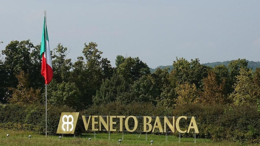 This Sept. 28, 2016 photo shows the name of the headquarters of Veneto Banca, on the outskirts of Montebelluna, near Treviso, Italy. Veneto Banca was an integral part of the community before it collapsed, causing losses for thousands of savers, many of them elderly, its demise is emblematic of the wider country's financial problems, which could get worse if the government collapses after a popular vote this weekend on Dec. 4, 2016. (AP Photo/Colleen Barry)
