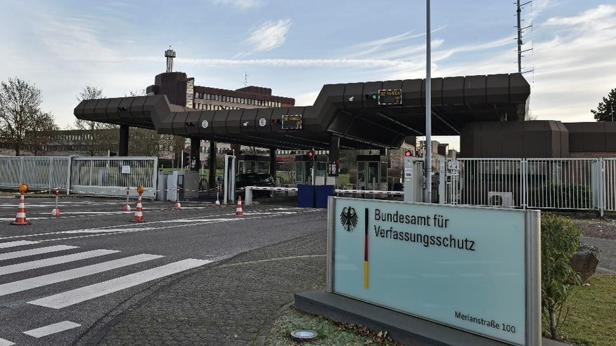 The entrance of the headquarters of the German domestic intelligence service, Bundesamt für Verfassungsschutz, is pictured in Cologne, Germany, on Wednesday, Nov. 30, 2016. Germany's domestic intelligence service says an employee suspected of trying to pass along sensitive material to Islamic extremists had only been working for the agency for a short time. (AP Photo/Martin Meissner)