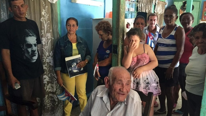 Fidel Castro's brother Martin Castro, 87, sits in his home surrounded by neighbors and other relatives in Biran, in the eastern province of Holguin, Cuba, Tuesday, Nov. 29, 2016. Martin remembers the late Cuban leader as a restless child who enjoyed horse riding and hunting in the mountains near his hometown of Biran. Martin says he doesn't much like to travel so he didn't see Fidel very often, but he's grateful to see Cubans across the island paying tribute to his brother. (AP Photo/Mauricio Munoz)