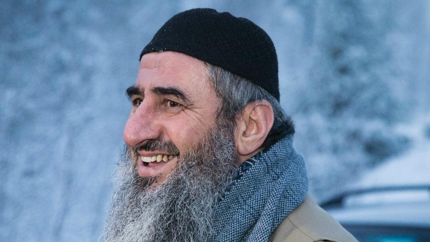 FILE - In this Jan. 25, 2015 file photo, Iraqi-born cleric Mullah Krekar, smiles after being released from Kongsvinger prison, in Kongsvinger, Norway. Italy has decided to pull back an extradition request for Najmaddin Faraj Ahmad, also known as Mullah Krekar, Norway's security service said on Wednesday, Nov. 30, 2016. (Audun Braastad, NTB scanpix via AP, File)