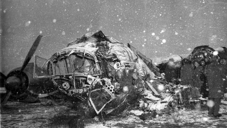 FILE - In this Feb. 6, 1958 file photo snow falls on the wreck of British European Airways Flight 609 which crashed on take-off at Munich, Germany. On board the plane was the Manchester United football team, nicknamed the Busby Babes, along with supporters and journalists. Twenty-three of the 44 passengers on board the aircraft died in the crash.  (AP Photo/File)