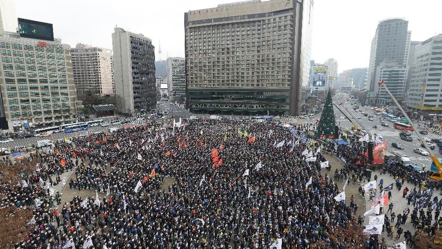 Protesters stage a rally calling for South Korean President Park Geun-hye to step down in Seoul, South Korea, Wednesday, Nov. 30, 2016. South Korea's three main opposition parties agreed Wednesday to stick to their plans to impeach Park, dismissing as a stalling tactic by her offering to resign if parliament arranges a safe transfer of power. (AP Photo/Ahn Young-joon).
