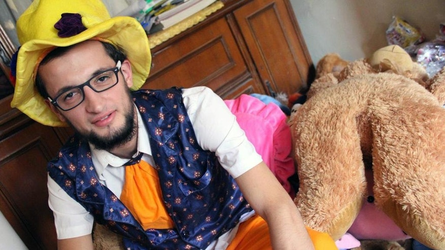This undated photo courtesy of Ahmad al-Khatib, a media activist in Aleppo, shows Syrian social worker Anas al-Basha, 24, dressed as a clown, while posing for a photograph at his home in Aleppo, Syria. Al-Basha, was a center director at Space for Hope, one of the many important but unheralded local initiatives that has operated against the odds to provide the services of civil society in Syria's war-torn opposition areas. He was killed on Tuesday, Nov. 29, 2016 in a presumed government or Russian ballistic missile strike on the Mashhad neighborhood in the besieged, eastern side of Aleppo city. (Courtesy of Ahmad al-Khatib, via AP)
