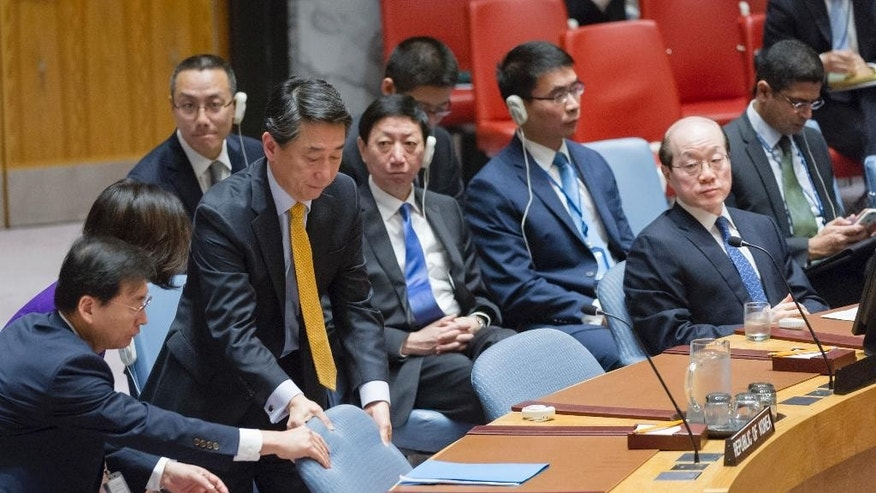In this Wednesday, Nov. 30, 2016 photo provided by the United Nations, Oh Joon, South Korea's ambassador to the United Nations, takes a seat at a Security Council meeting at U.N. headquarters. The council voted Wednesday to further tighten sanctions on North Korea in response to their fifth and largest nuclear test in September. (Rick Bajornas/United Nations via AP)