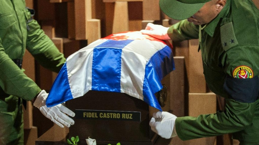 "The small coffin containing the ashes of the late Cuban leader Fidel Castro is placed by honor guards at the Ernesto ""Che"" Guevara mausoleum in Santa Clara, Cuba, early Thursday, Dec. 1, 2016. Castro's ashes completed the first leg of a four-day journey across Cuba from Havana to their final resting place in the eastern city of Santiago. (Fernando Medina/Cubahora via AP )"
