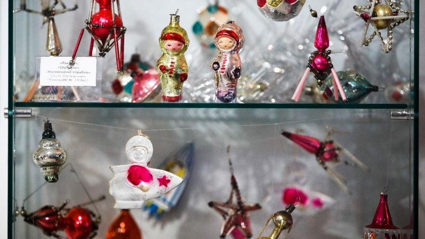 In this photo taken on Thursday, Nov. 24, 2016, Soviet-era Christmas decorations are on display in the Christmas decorations museum in Klin, about 85 kilometers (53 miles) northwest of Moscow. Some of this decorations made in 1960th depict Soviet-era cosmonauts. (AP Photo/Pavel Golovkin)