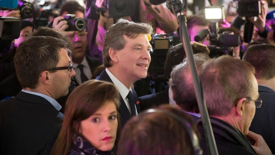 Leftist contender for the Socialist primary election Arnaud Montebourg surrounded by reporters leaves the river boat after he officially launched his primary campaign for France's presidential election in spring next year in Paris, Thursday, Dec. 1, 2016. (AP Photo/Michel Euler)
