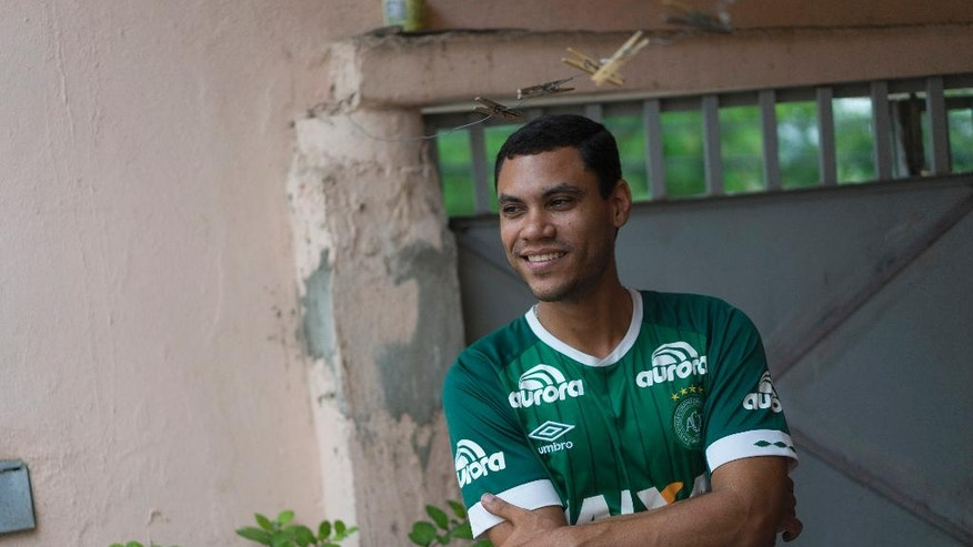 "Helam Marinho Zampier, Jr. smiles as he talks about his brother Neto, Brazil's Chapecoense soccer player who survived a plane crash in Colombia that killed most of his teammates, at his home in Rio de Janeiro, Brazil, Thursday, Dec. 1, 2016. ""On one hand, we are very happy because our family member, Neto, is alive,"" said Zampier. ""But at the same time, we are grieving because other lives were lost."" (AP Photo/Leo Correa)"