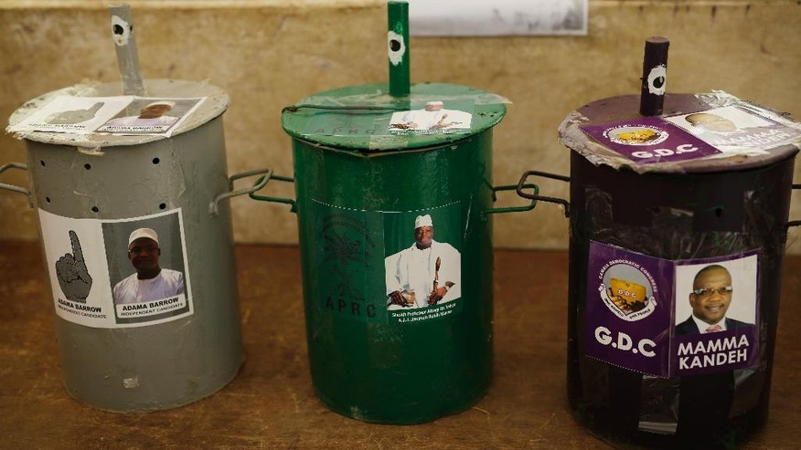 Three ballot drums are set in a polling station in Serrekunda, Gambia, Wednesday Nov. 30, 2016, on the eve of the presidential elections where Opposition coalition candidate Adama Barrow will face longtime President Yahya Jammeh and third party candidate Mama Kandeh. Voters will choose their candidate by placing a clear glass marble inside the drum of their choice. (AP Photo/Jerome Delay)