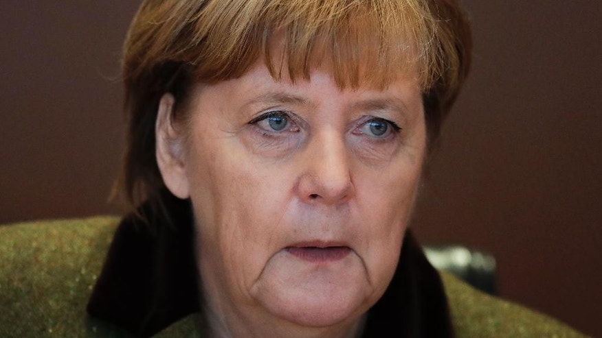 German Chancellor Angela Merkel leads the weekly cabinet meeting of the German government at the chancellery in Berlin, Wednesday, Nov. 30, 2016. (AP Photo/Markus Schreiber)
