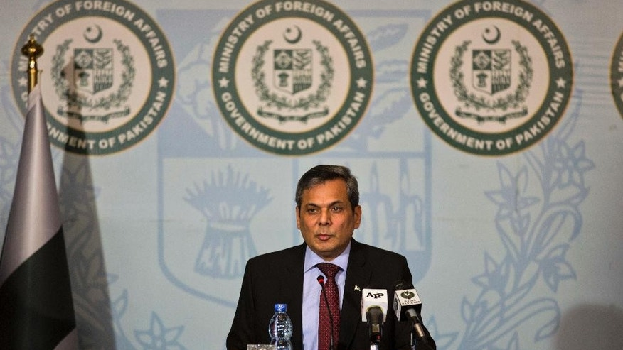 FILE - In this Thursday, Sept. 22, 2016 file photo, Pakistan's Foreign Ministry spokesman Nafees Zakaria speaks during a weekly briefing in Islamabad, Pakistan. Pakistan's foreign ministry spokesman says on Thursday, Dec. 1, 2016, Pakistan welcomes U.S. President-elect Donald Trump's willingness to play his role in resolving its outstanding problems with New Delhi. (AP Photo/B.K. Bangash, File)