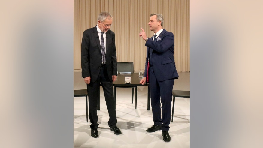 FILE - In this Nov. 27, 2016 photo Alexander Van der Bellen, candidate of the Austrian Greens, left, and Norbert Hofer of Austria's Freedom Party, FPOE, wait for the start of a TV debate in Vienna, Austria. Austrians are choosing Sunday, Dec. 4, 2016 between a moderate and a populist for president _ and both candidates are hoping to exploit the Trump effect in the first European Union nation facing such a choice since the U.S election. (AP Photo/Ronald Zak, file)