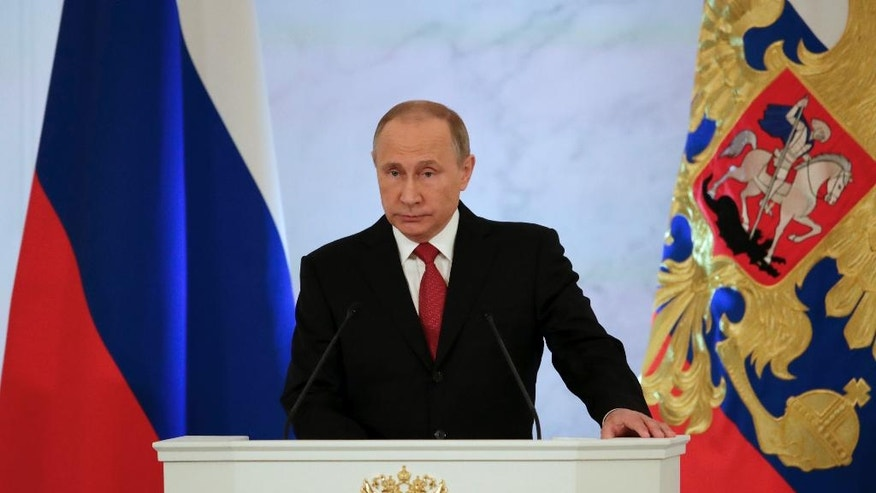 Russian President Vladimir Putin speaks as he gives his annual state of the nation address in the Kremlin in Moscow, Russia, Thursday, Dec. 1, 2016. (AP Photo/Pavel Golovkin)