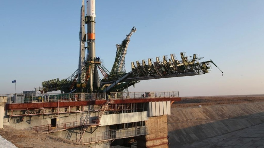 In this photo dated Tuesday, Nov, 29, 2016 the Soyuz-FG rocket booster with the Progress MS-04 cargo ship is installed on a launch pad in Baikonur, Kazakhstan.  The unmanned Russian cargo space ship Progress MS-04 broke up in the atmosphere over Siberia on Thursday Dec. 1, 2016,  en route to the International Space Station due to an unspecified malfunction, the Russian space agency said. (Sergei Sergeev/ Roscosmos Space Agency Press Service photo via AP)