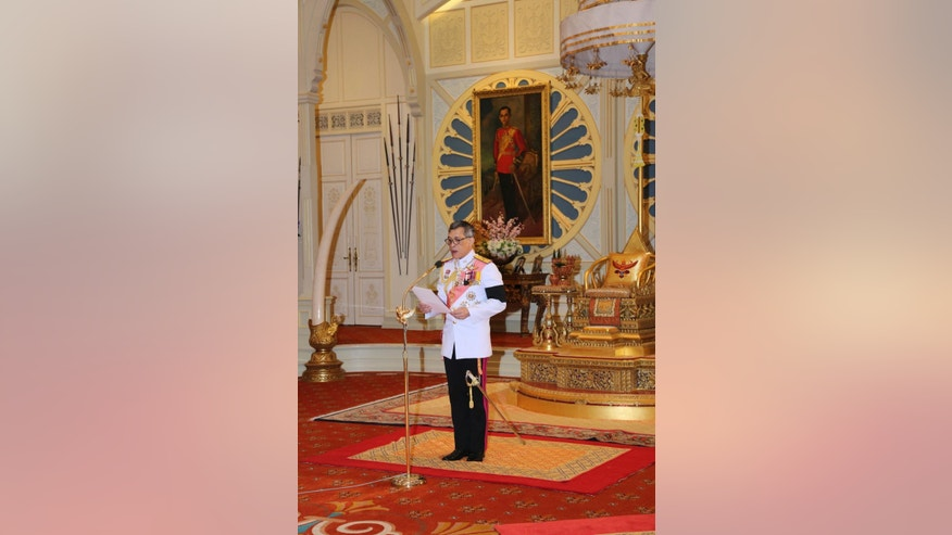 In this photo release by Bureau of the Royal Household, Thailand 's new king Maha Vajiralongkorn Bodindradebayavarangkun speaking after acceptance throne at Dusit Palace Thursday, Dec.1, 2016 in Bangkok, Thailand. Thailand has a new king, with the country's crown prince formally taking the throne to succeed his much-revered late father, who reigned for 70 years. (Bureau of the Royal Household via AP)