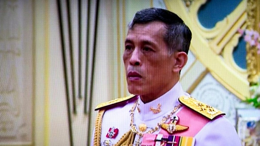 """In this image made from video, Thailand's Crown Prince Maha Vajiralongkorn, listens to the invitation to ascend to the throne from National Legislative Assembly President Pornpetch Wichitcholchai, at the Grand Palace in Bangkok, Thailand,Thursday, Dec. 1, 2016. The new monarch, who received the title """"His Majesty King Maha Vajiralongkorn Bodindradebayavarangkun,"""" assumed his new position Thursday, according to an announcement broadcast on all TV channels. He will also be known as Rama X, the tenth king in the Chakri dynasty that was founded in 1782. (Thai TV Pool via AP)"""
