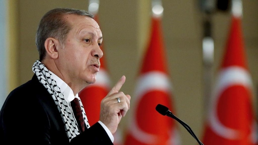 Turkey's President Recep Tayyip Erdogan addresses a parliamentary symposium on Jerusalem, in Istanbul, Tuesday, Nov. 29, 2016. Erdogan has urged Muslims to defend the Palestinian cause, striking a tough stance on Israel despite improved ties between the two nations. (Murat Cetinmuhurdar/Presidential Press Service, Pool photo via AP)