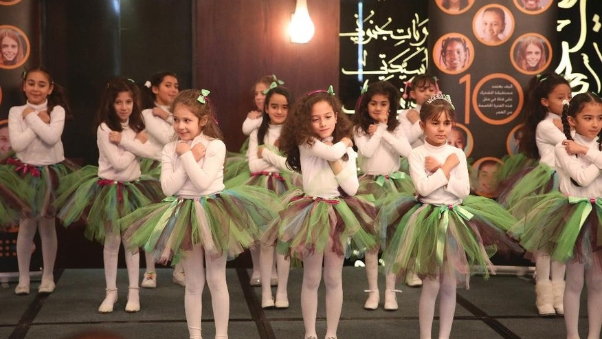Students from the Princess Alia School for Girls sing a song about gender equality at a press conference for the release of the 2016 State of the World Population report by the United Nations Population Fund on Thursday, Dec. 1, 2016 in Amman, Jordan. (Sam McNeil/AP Photo)