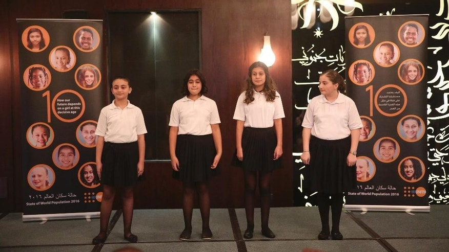 Students from the Al Ahliya School for Girls sing a song about gender equality at a press conference for the release of the 2016 State of the World Population report by the United Nations Population Fund on Thursday, Dec. 1, 2016 in Amman, Jordan. (Sam McNeil/AP Photo)