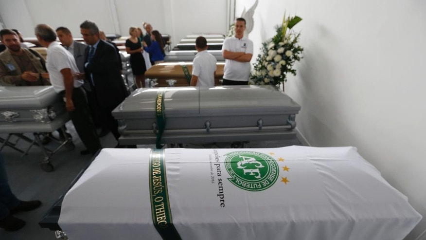A white sheet with a Chapecoense soccer team logo covers a coffin containing the remains of a team member, in Medellin, Colombia, Thursday, Dec. 1, 2016. Forensic authorities say they have managed to identify a majority of the victims of Monday's Colombian air tragedy and hope to finish their work on Thursday. (AP Photo/Fernando Vergara)