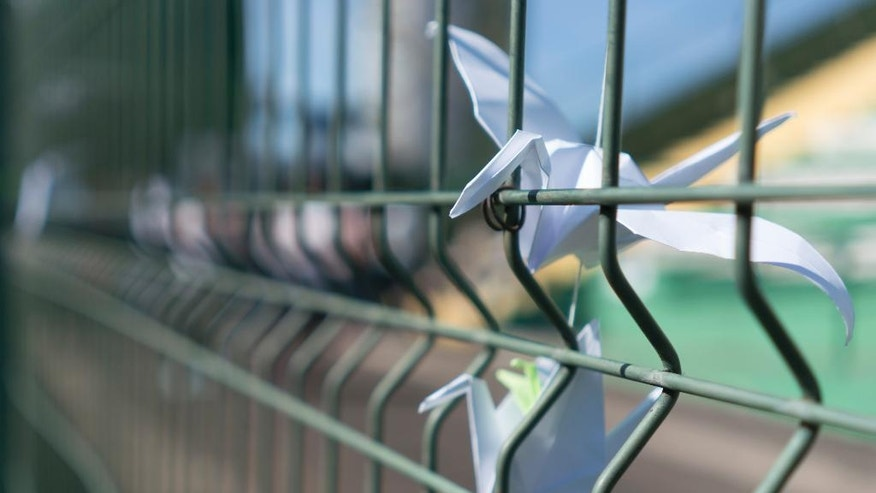 Paper cranes adorn the gates of the stadium Arena Conda, home of the Chapecoense Brazilian soccer team, in Chapeco, Brazil, Friday, Dec. 2, 2016. Members of the team and a group of journalists perished on a chartered flight earlier in the week. They were headed to the Copa Sudamericana finals when the chartered plane they were travelling in ran out of fuel, crashing into the Andes outside Medellin. (AP Photo/Renata Brito)