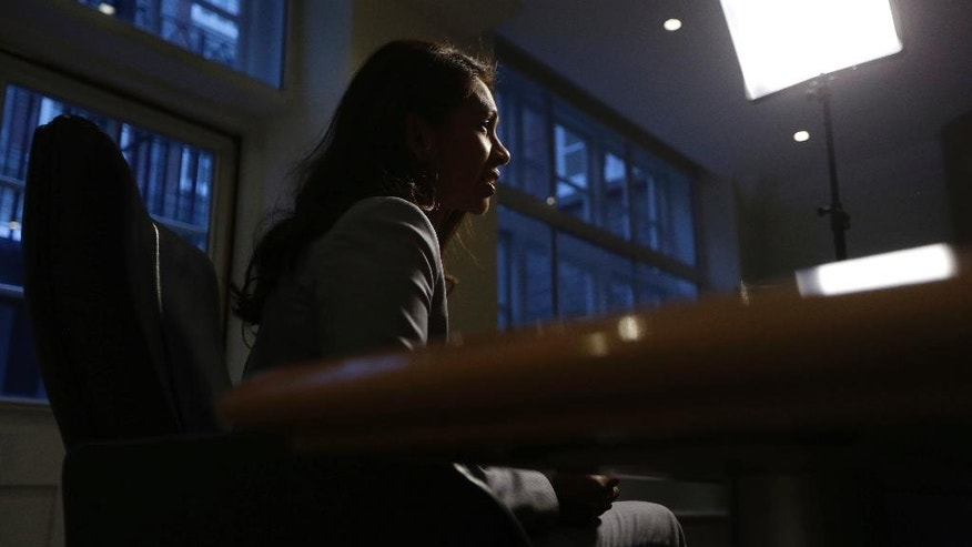 "In this Thursday, Dec. 1, 2016 photo, Gina Miller, a founder of investment management group SCM Private, speaks during an interview with The Associated Press in London. The financial entrepreneur says she has received death threats and racial and sexual abuse since she won a High Court ruling forcing the British government to seek Parliamentary approval before leaving the European Union. She's hired bodyguards and made ""different arrangements'' for her children at school. (AP Photo/Matt Dunham)"