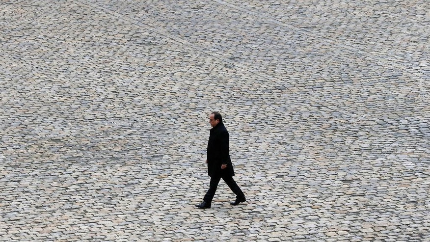 "FILE - In this Friday, Nov. 27, 2015 file picture, French President Francois Hollande walks in the courtyard of the Invalides national monument during a ceremony in Paris, France. French President Francois Hollande says he decided against running for another term because he wants to give his Socialist party a chance to win ""against conservatism and extremism."" (AP Photo/Francois Mori, File)"