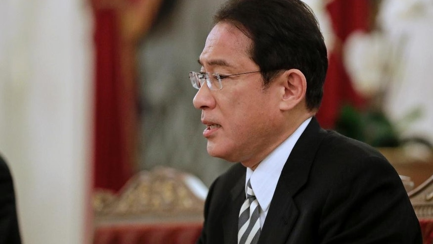 Japanese Foreign Minister Fumio Kishida speaks at his meeting with Russian President Vladimir Putin in St. Petersburg, Russia, Friday, Dec. 2, 2016. Putin is to travel to Japan later this month to meet the Japanese prime minister and discuss a territorial dispute over the southern Kuril islands which keeps the two countries from signing a peace treaty formally ending their World War II hostilities. (AP Photo/Dmitri Lovetsky, pool)