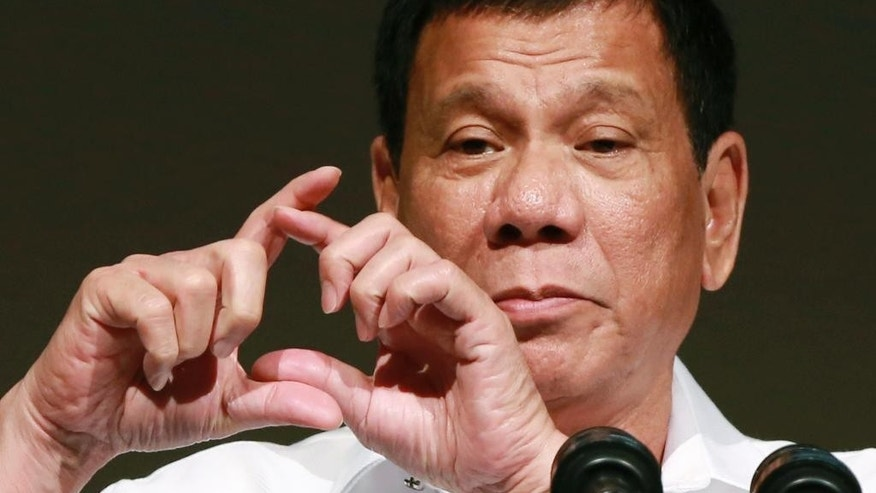 "FILE - In this Oct. 26, 2016, file photo, Philippine President Rodrigo Duterte delivers a speech at the Philippine Economic Forum in Tokyo. Duterte telephoned U.S. President-elect Donald Trump late Friday, Dec. 2 and had a brief but ""very engaging, animated conversation"" in which both leaders invited each other to visit his country.  In a video released by Duterte's close aide, Bong Go, the Philippine leader is seen smiling while talking to Trump late Friday and saying: ""We will maintain ... and enhance the bilateral ties between our two countries.""  (AP Photo/Eugene Hoshiko, File)"