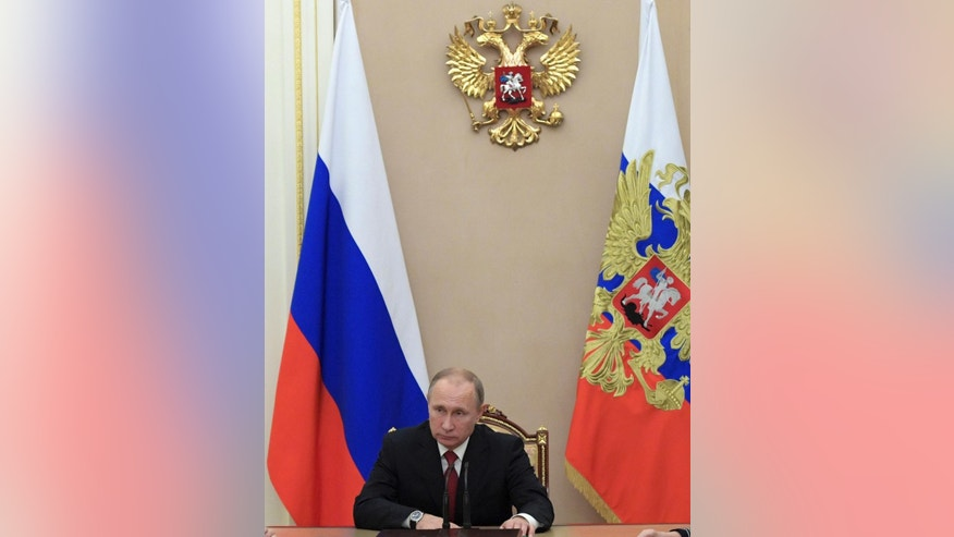 Russian President Vladimir Putin chairs a Security Council meeting in the Kremlin in Moscow, Russia, Thursday, Dec. 1, 2016. (Alexei Druzhinin, Sputnik, Kremlin Pool Photo via AP)