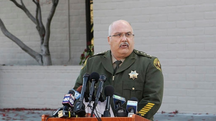 FILE - In this Nov. 30, 2016 file photo, Shasta County Sheriff Tom Bosenko speaks at a news conference to discuss the Sherri Papini case in Redding, Calif. Three weeks after Papini disappeared, the question of whether she was dead or alive was answered when the young mother and wife was spotted waving frantically for help along a California freeway early on Thanksgiving morning. But the mystery over what happened to her during those 22 days just seemed to grow deeper (Andreas Fuhrmann/The Record Searchlight via AP, File)