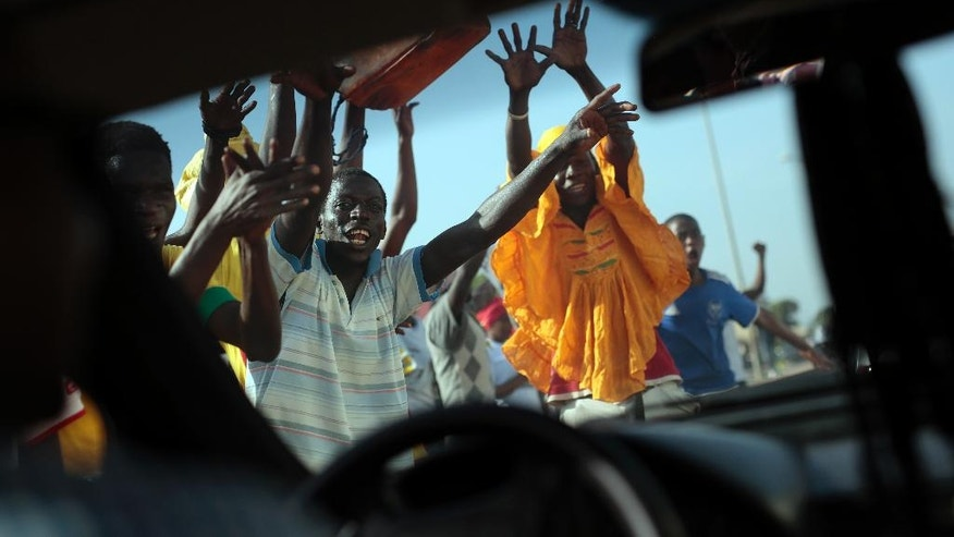 Gambians celebrate the victory of opposition coalition candidate Adama Barrow against longtime President Yahya Jammeh in the streets of Serrekunda, Gambia, Friday Dec. 2, 2016. (AP Photo/Jerome Delay)