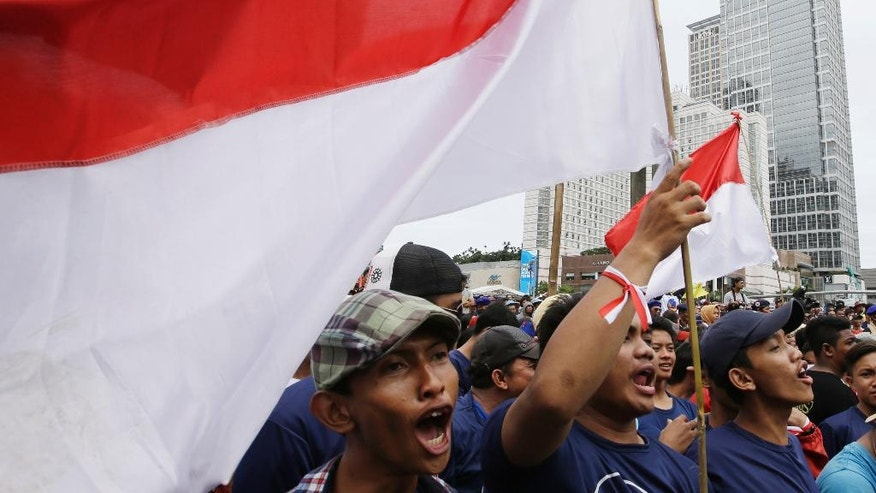 Local shout slogans during a rally in Jakarta, Indonesia, Sunday, Dec. 4, 2016. Thousands of Indonesians rallied in the center of the capital Jakarta on Sunday, calling for tolerance and unity after massive protests by conservative Muslims against the city's minority Christian governor. (AP Photo/Achmad Ibrahim)
