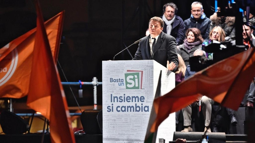 Italian Premier Matteo Renzi addresses a rally on the upcoming Italian constitutional referendum in Florence, Italy, Friday, Dec. 2, 2016. (Maurizio Degl'Innocenti/ANSA via AP)