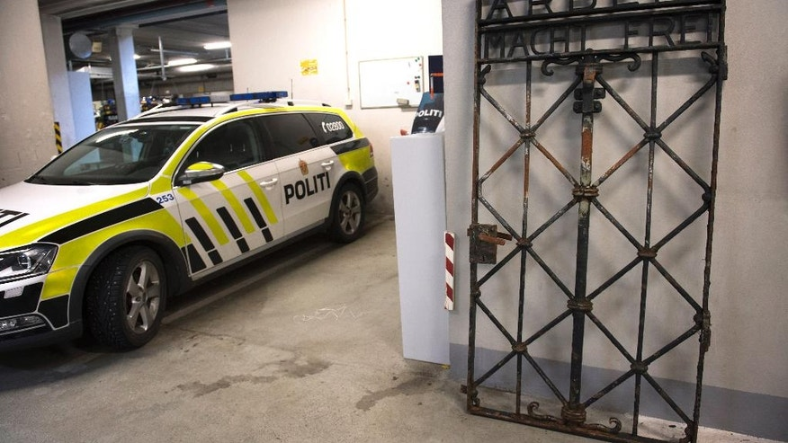 "The iron gate from the former Nazi concentration camp in Dachau, southern Germany, with the slogan ""Arbeit macht frei"" (""Work will set you free"") is displayed Saturday Dec. 3, 2016, after being found earlier this week by police in Bergen, Norway. The infamous wrought iron gate was stolen two years ago, and is being cared for by police in Bergen before being returned to Germany. (Marit Hommedal / NTB scanpix via AP)"
