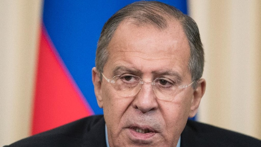 Russian Foreign Minister Sergey Lavrov speaks during a news conference following his talks with Japanese Foreign Minister Fumio Kishida in Moscow, Russia, Saturday, Dec. 3, 2016. Russian President Vladimir Putin is going to travel to Japan later this month to meet the Japanese prime minister and discuss a territorial dispute over the southern Kuril islands which keeps the two countries from signing a peace treaty formally ending their World War II hostilities. (AP Photo/Pavel Golovkin)
