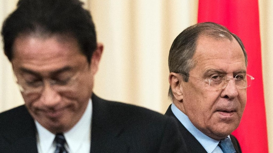Russian Foreign Minister Sergey Lavrov, right, and Japanese Foreign Minister Fumio Kishida, arrive to attend a news conference following their talks in Moscow, Russia, Saturday, Dec. 3, 2016. Russian President Vladimir Putin is going to travel to Japan later this month to meet the Japanese prime minister and discuss a territorial dispute over the southern Kuril islands which keeps the two countries from signing a peace treaty formally ending their World War II hostilities. (AP Photo/Pavel Golovkin)