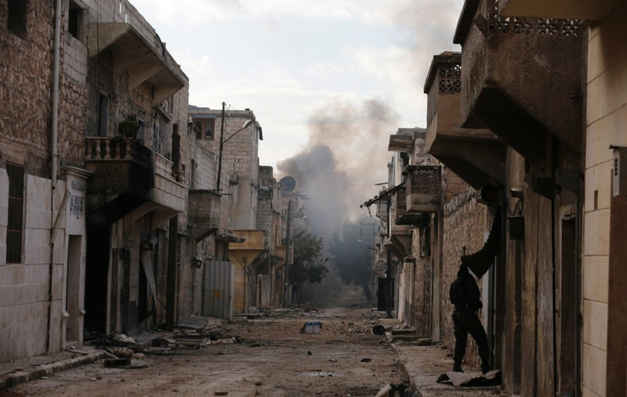 Smoke rises in the east Aleppo neighborhood of Tariq al-Bab after insurgents militants launch a mortar shell on government soldiers, Syria, Saturday, Dec. 3, 2016. Tariq al-Bab was captured by Syrian government forces on Friday. (AP Photo/Hassan Ammar)