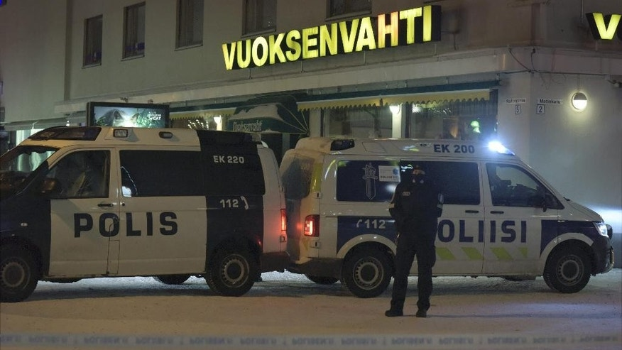 Police guard the area where three women were killed in a shooting incident outside of a restaurant in Imatra, Finland after midnight, Sunday, Dec. 4, 2016. A gunman killed a local town councilor and two journalists, all women, in an apparent random shooting in a nightlife district in a small town in southeastern Finland, police said Sunday. A male suspect has been detained. (Hannu Rissanen/Lehtikuva via AP)