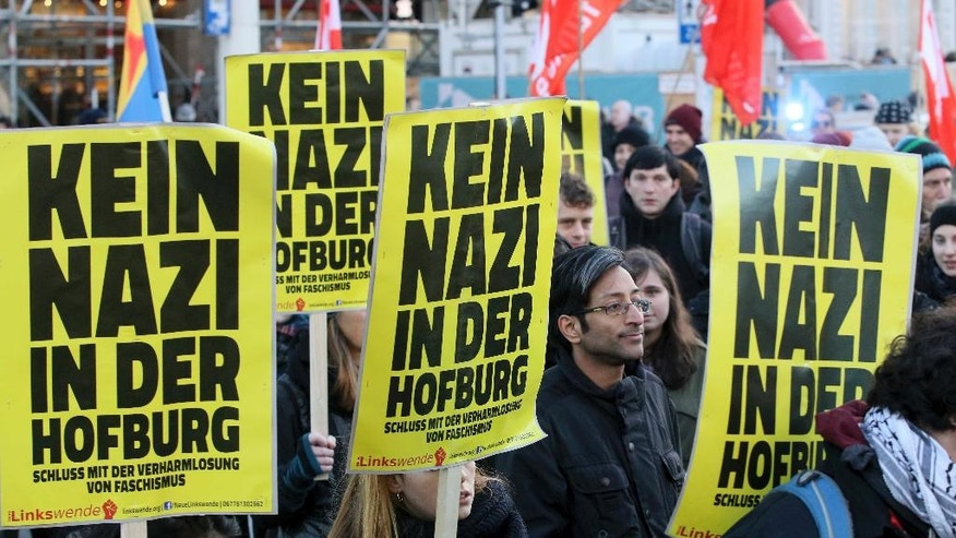 "Protesters walk with posters ""No nazi in the Hofburg"" during a demonstration against Norbert Hofer, candidate for presidential elections of Austria's right-wing Freedom Party, FPOE, in Vienna, Austria, Saturday, Dec. 3, 2016. The Hofburg is Austria's presidential palace.  (AP Photo/Ronald Zak)"